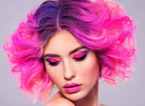 portrait of beautiful young woman with bright pink